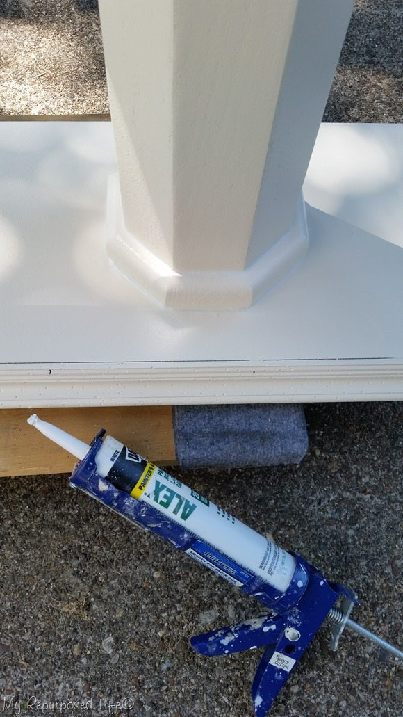 painter's caulk disguises gaps in table base