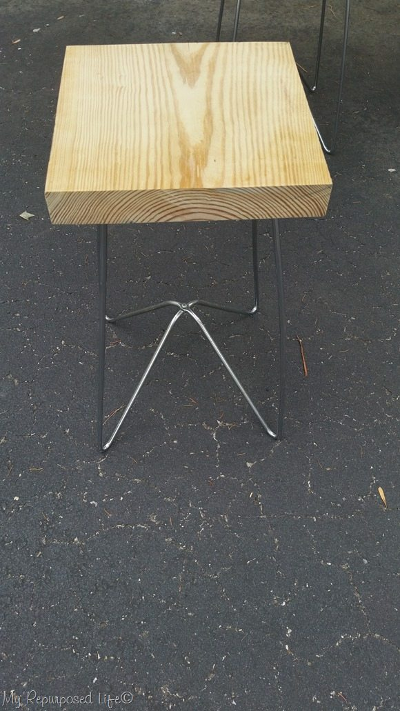 square wooden table with metal legs