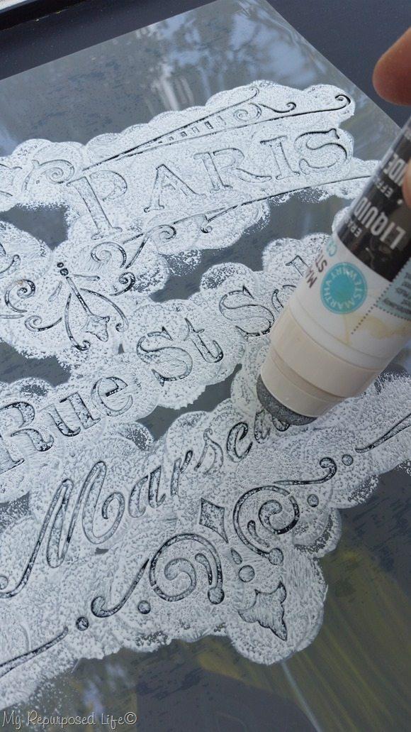 daubing liquid chalk paint on stencil