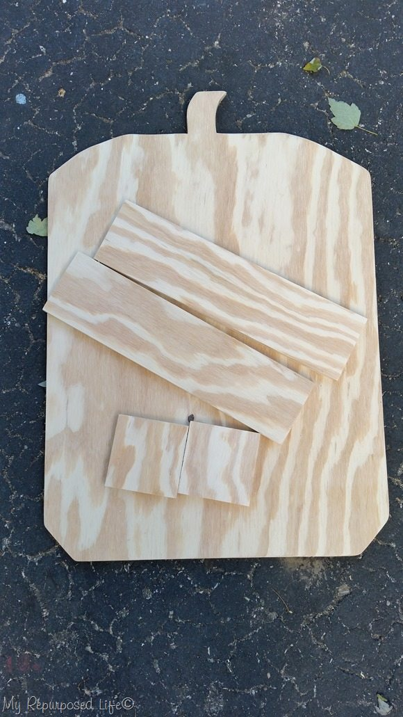 cut and sanded pieces to make pumpkin trick or treat candy holder