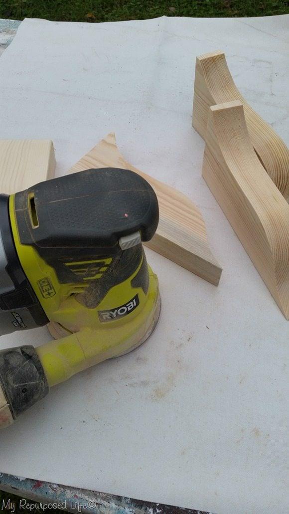 sanding drop off pieces porch post legs