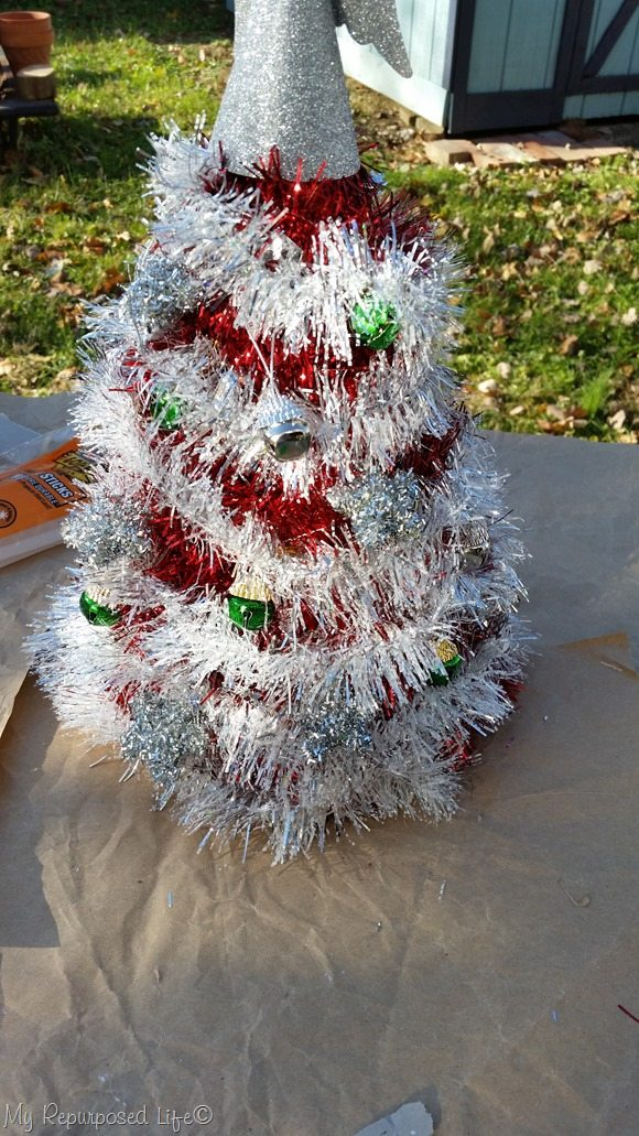 dollar tree red garland Christmas Tree made out of a Birthday hat and other dollar tree items