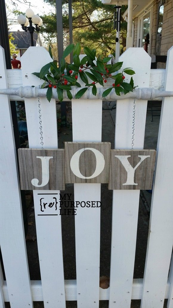 How to make a Joy wooden spindle sign for Christmas. An old spindle and reclaimed fence are the perfect combination for rustic Christmas Decor Joy Sign. #MyRepurposedLife #repurposed #spindle #joy #sign #Christmas #decor via @repurposedlife