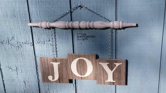 Joy spindle sign hanging on shed