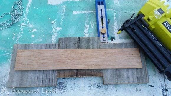 brad nailer attaches plywood