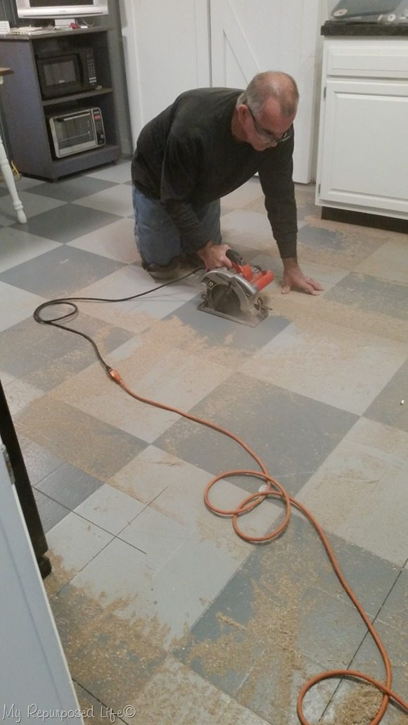 cut layers of flooring into manageable pieces