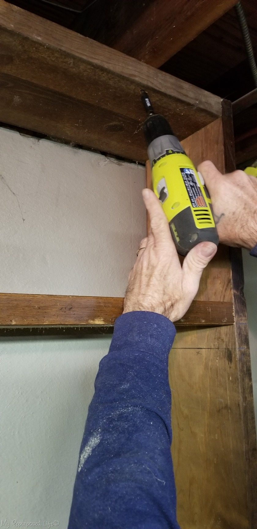 secure shelf to ceiling rafters