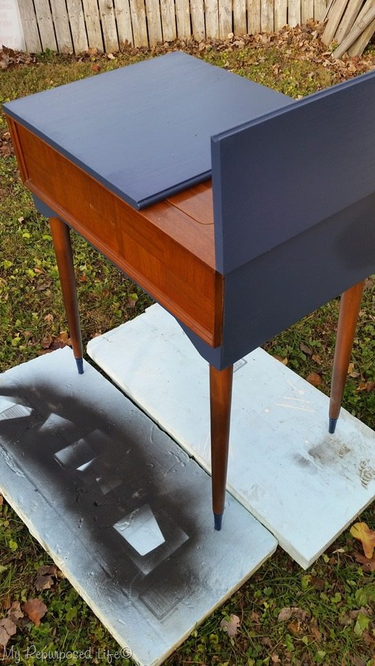 sewing cabinet makeover with navy blue paint
