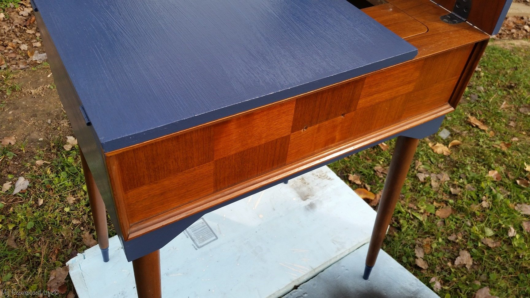 two toned navy blue sewing cabinet