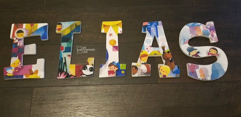 how to decoupage wooden letters with it's a small world paper MyRepurposedLife.com