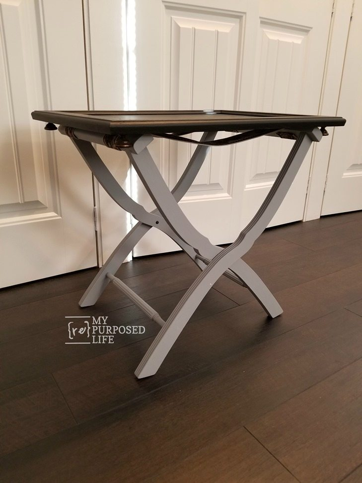 luggage rack with cabinet door tray as a table top MyRepurposedLife.com