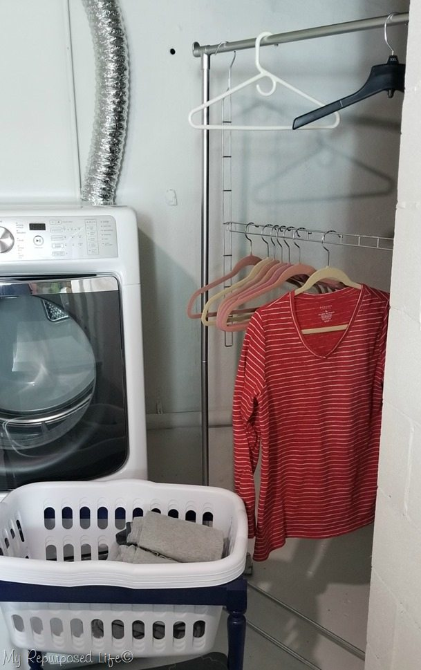cheap plastic garment rack painted with metallic spray paint for laundry room makeover