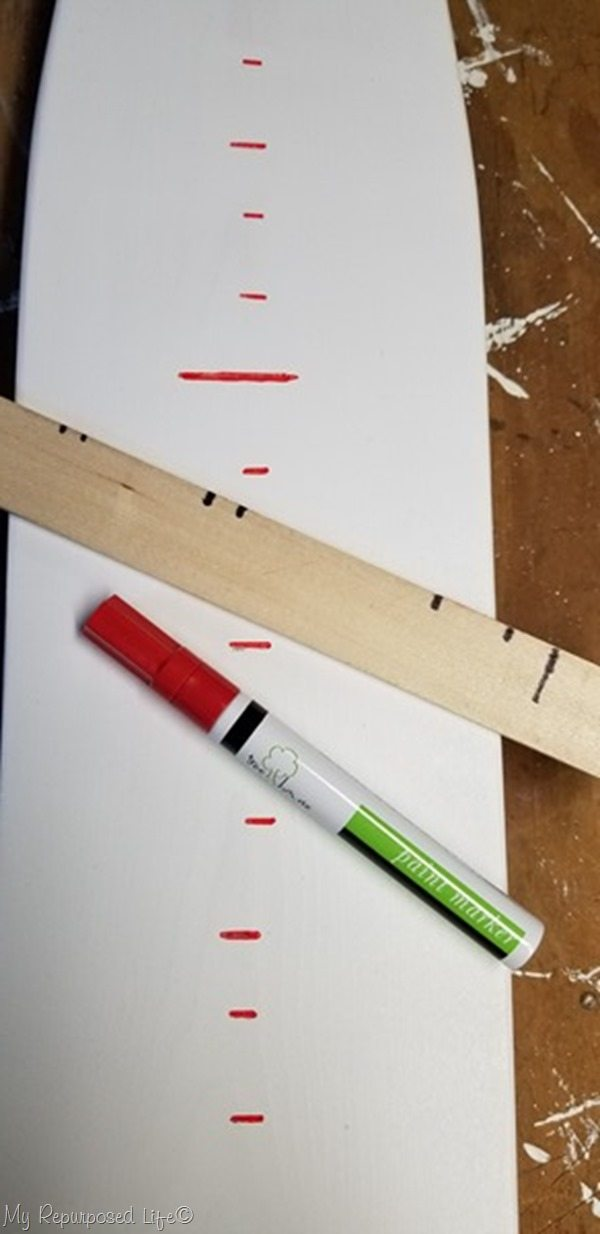 red paint pen marks growth chart