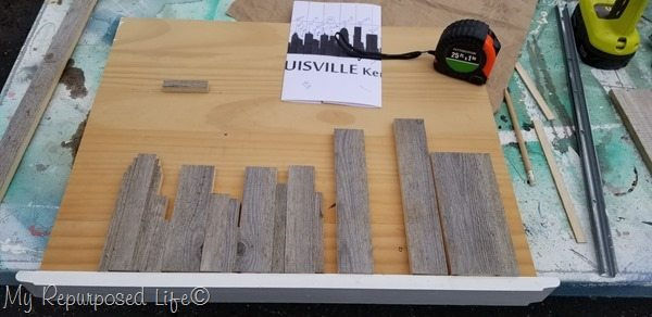 cutting small boards to make reclaimed wood skyline art