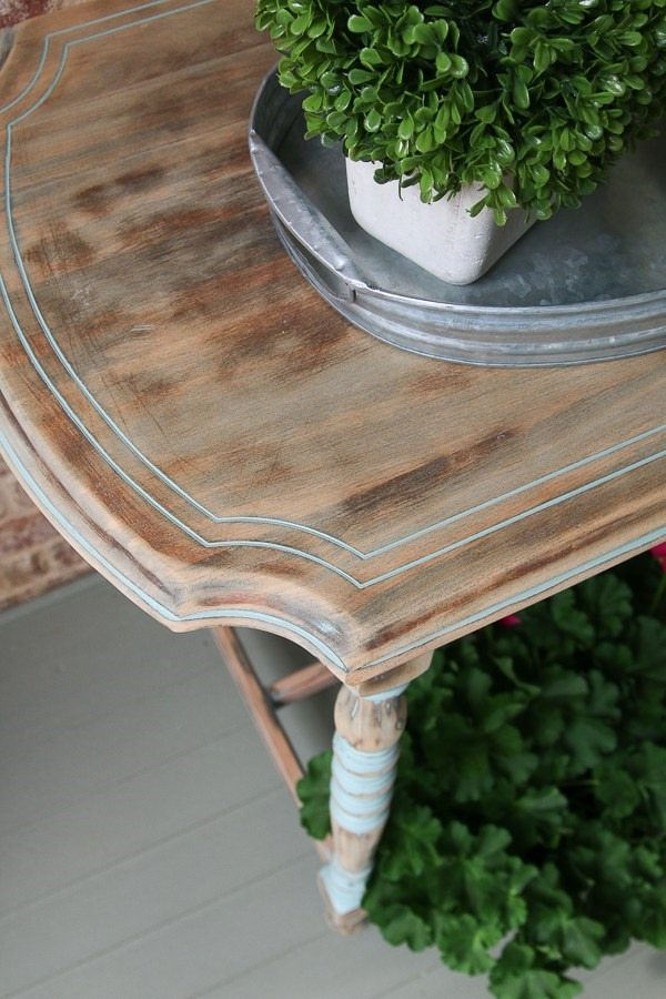 pretty console table on porch