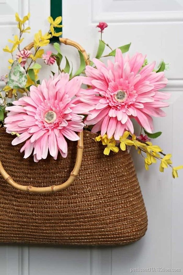 repurposed straw purse door decor with flowers
