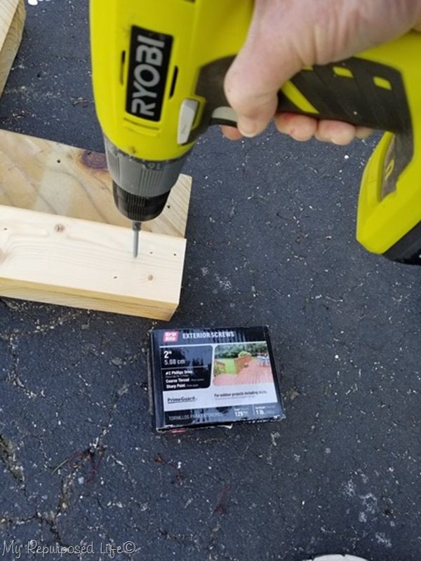 secure back leg on each stair stringer with wood screws