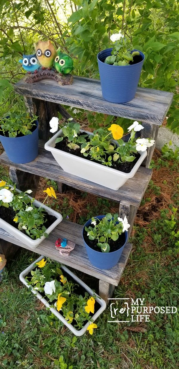 three tiered outdoor plant stand with pansies MyRepurposedLife.com