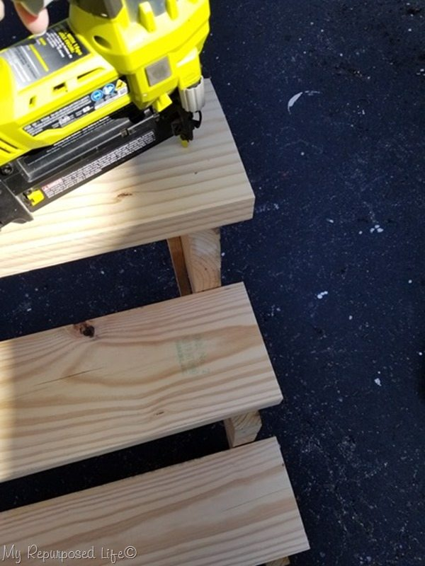 use brad nails to tack board in place