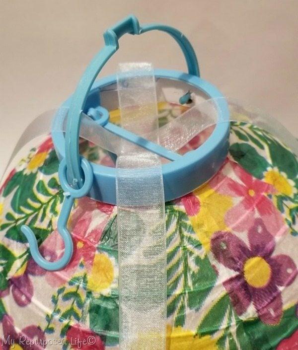weave ribbon under chinese lantern brace