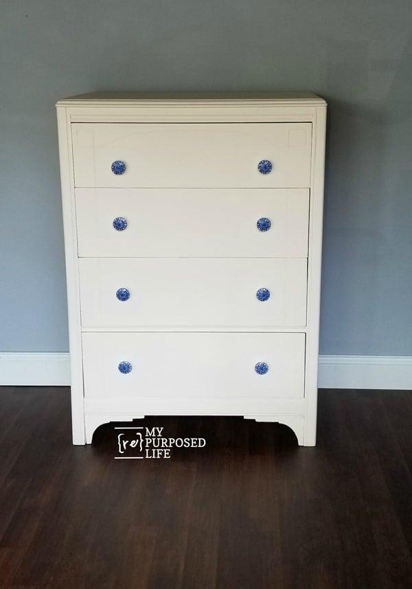 antique white dresser with decoupaged blue knobs MyRepurposedLife.com