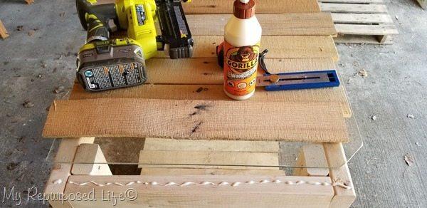 arrange pallet boards onto table top