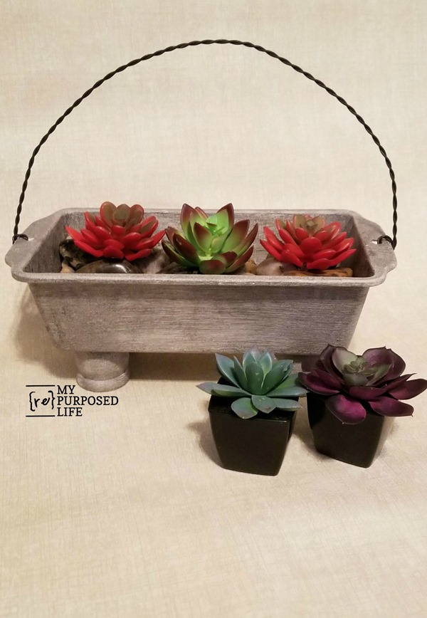 succulent planter made with loaf pan and twisted wire handle MyRepurposedLife.com