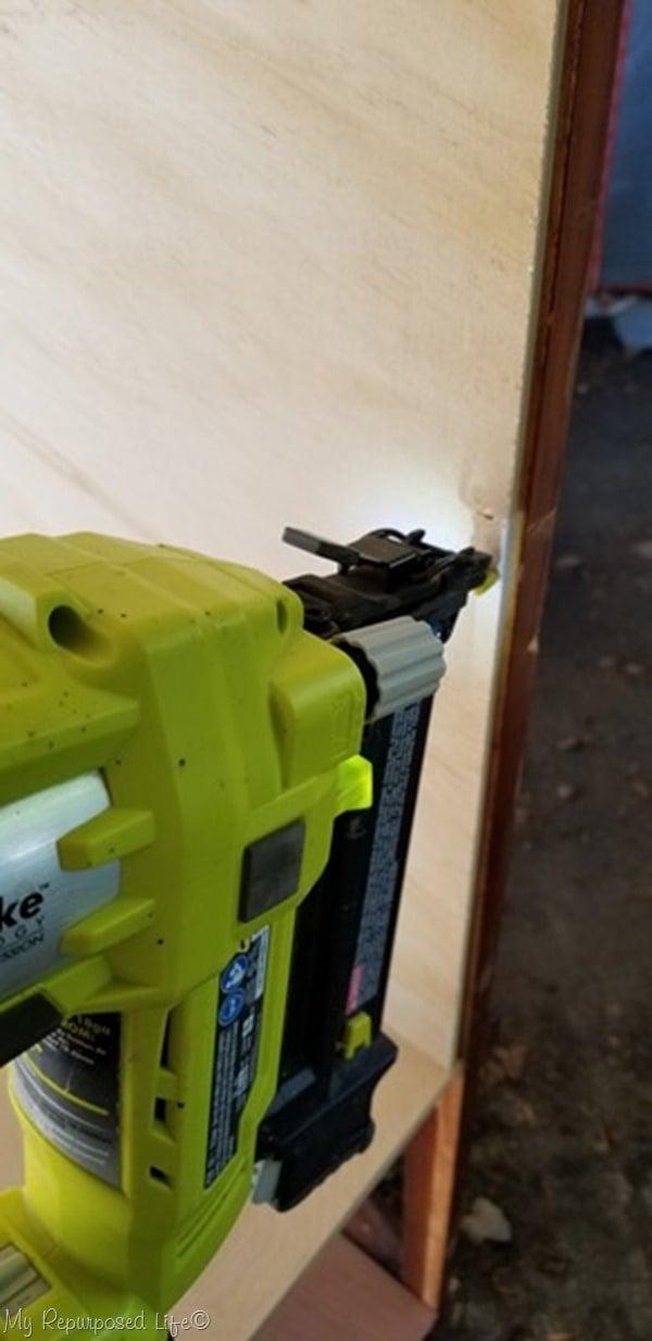 attach bookcase sides with nail gun