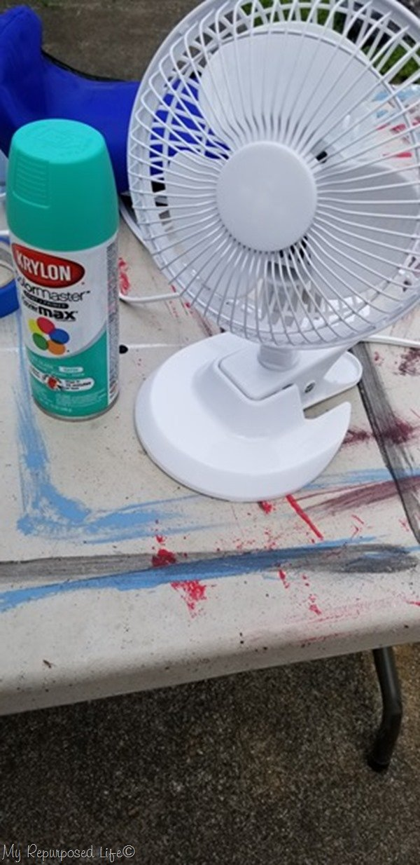 easy spray paint project paint a small fan for camper or dorm room