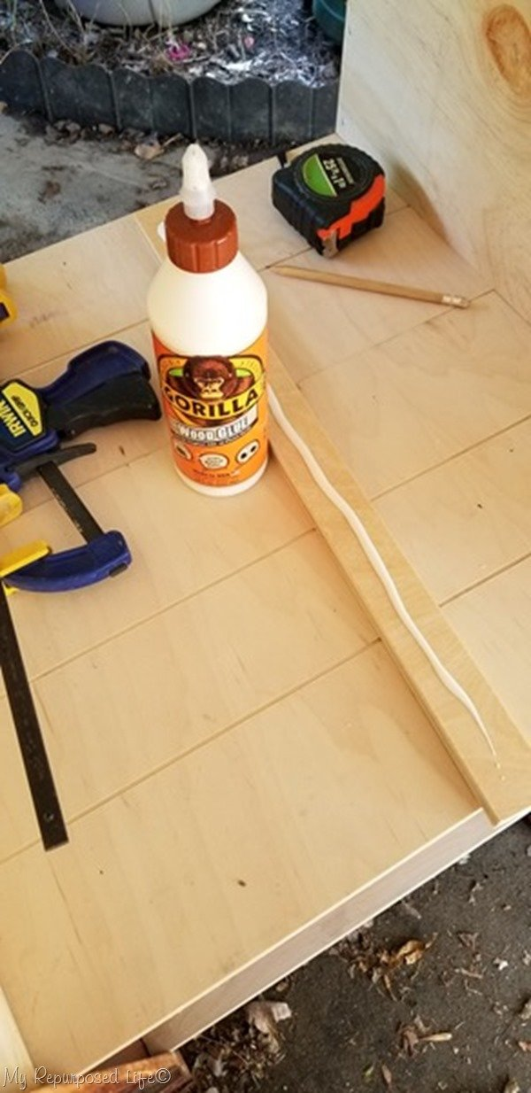 gorilla wood glue secures cleat for bookcase shelf