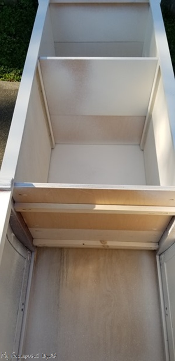 lay book shelf down to get underneath shelves