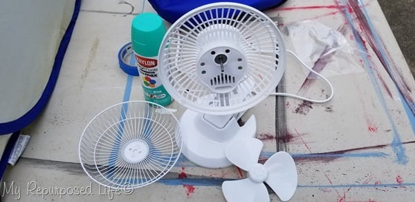 remove small fan blades in order to spray paint desk fan