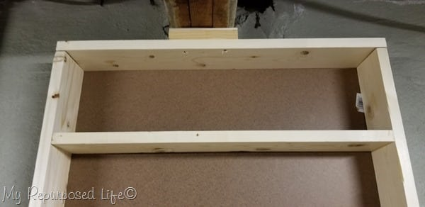 top of shelf unit attached to rafter