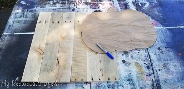 trace pumpkin shape onto pallet boards