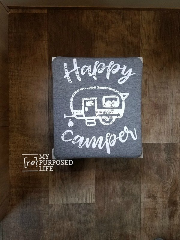 small ottoman footstool with Happy Camper t-shirt upholstered top MyRepurposedLife
