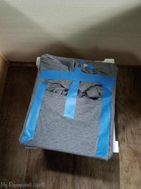 test fit t-shirt on ottoman