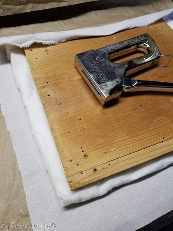trim drop cloth fabric to fit stool top