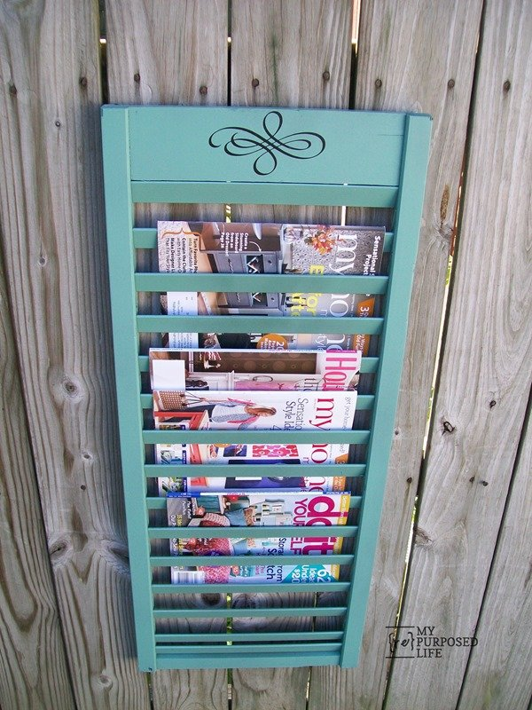 Easy repurposed shutter project uses part of a bi-fold door with every other slat removed to make a shutter magazine rack. Fun idea to keep you organized. Step by step directions with great tips on removing slats! #MyRepurposedLife #repurposed #upcycle #shutter via @repurposedlife