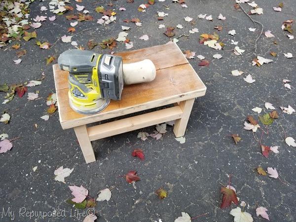 orbital sander smooths rough corners on oversized stepstool
