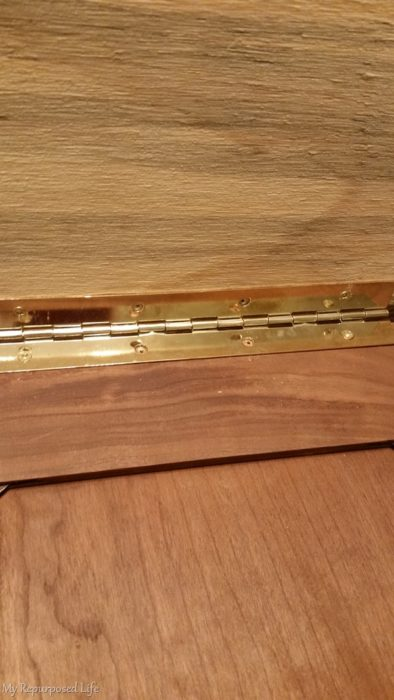 cabinet door repurposed into pet ramp with a piano hinge