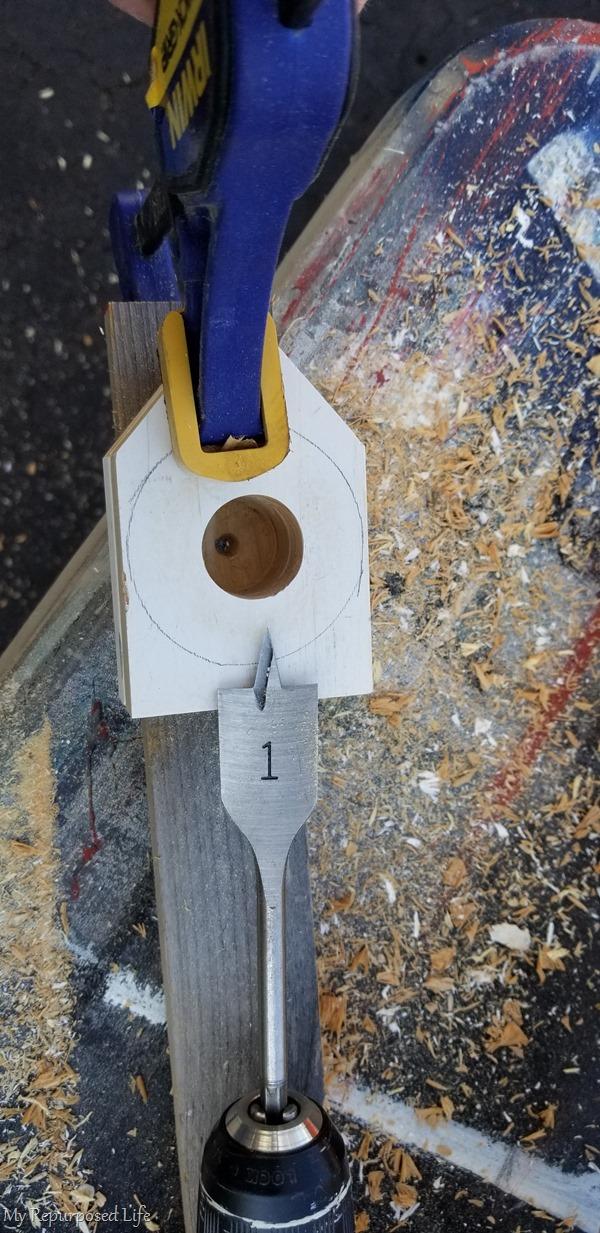drill hole in roll paper bracket