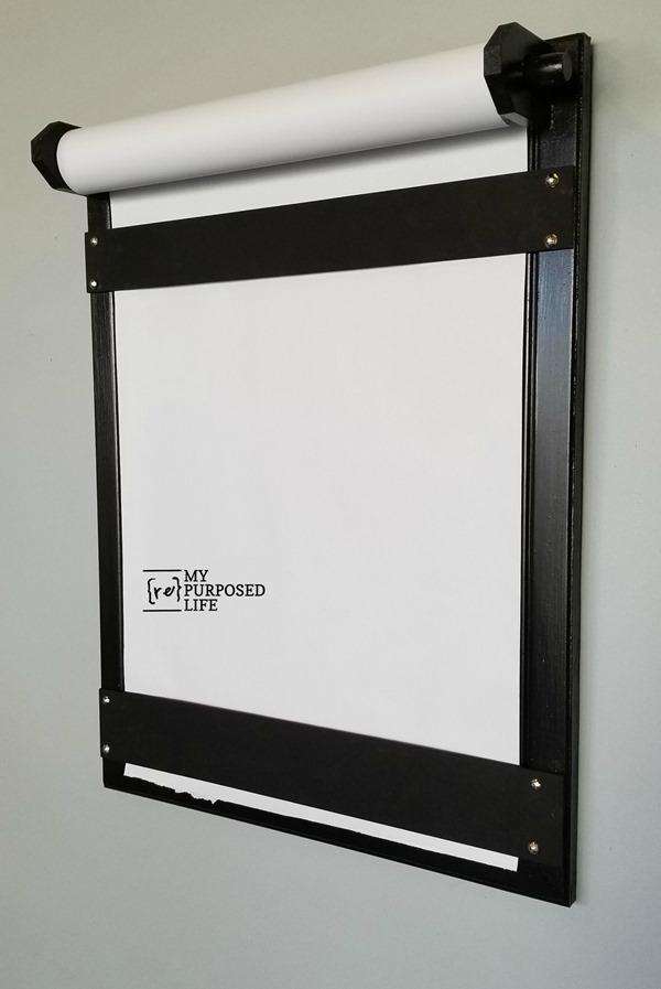 how to use a cabinet door to make a diy craft paper dispenser MyRepurposedLife
