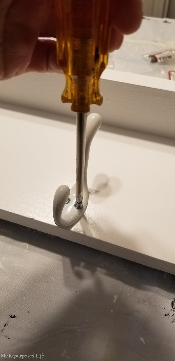 secure screw with screwdriver instead of power drill