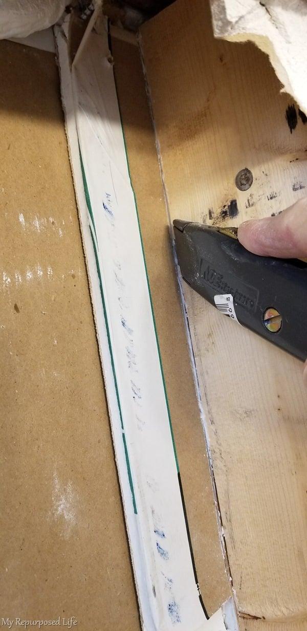 cut away scrap drywall pieces