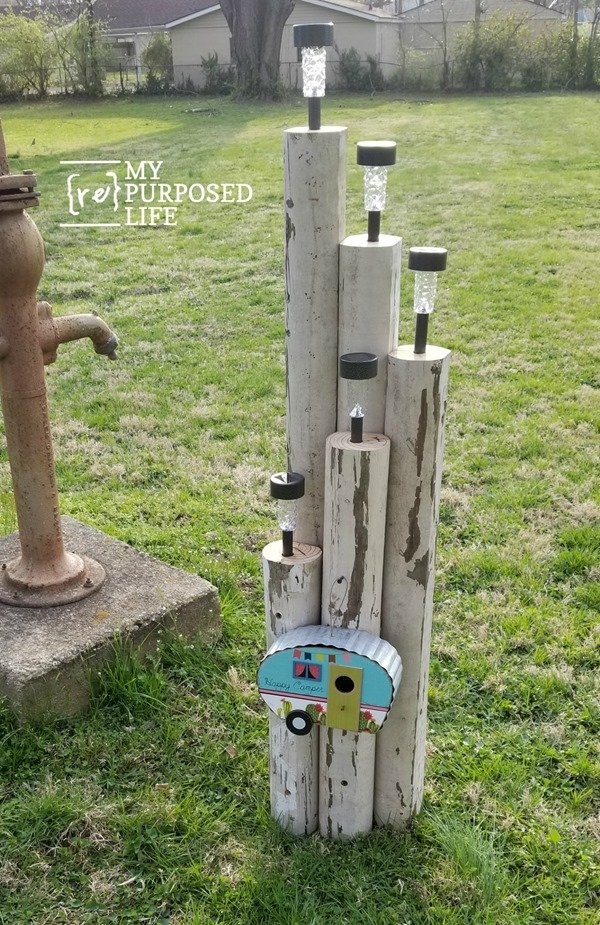 happy camper solar light feature using dollar store solar lights and landscape timbers