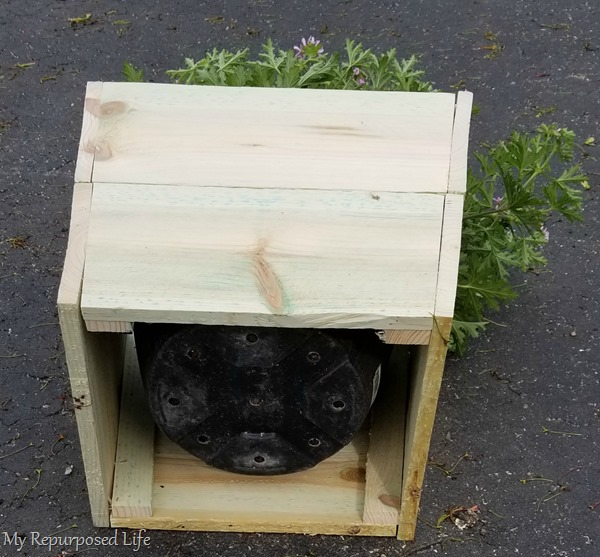 simple wooden planter to cover up plastic flower pot has not bottom