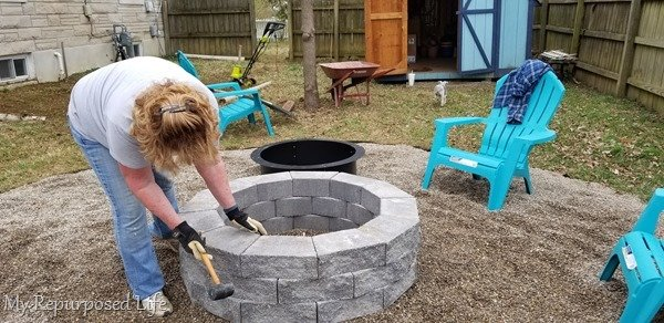 tap retaining wall pavers with rubber mallet