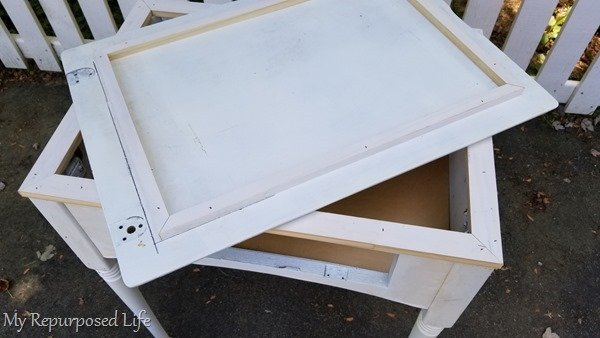 frame the top of the sewing machine cabinet