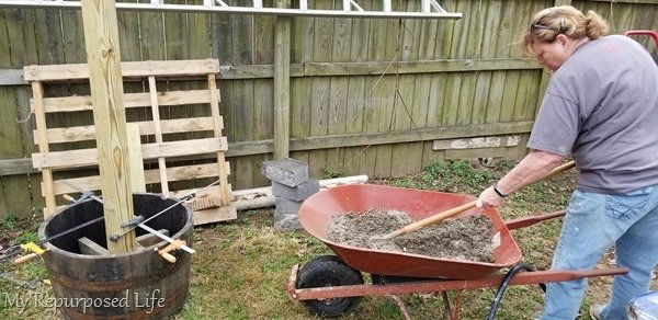 mix concrete in a wheelbarrow