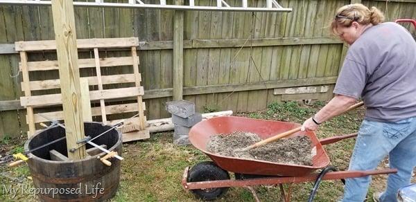 mix concrete in a wheelbarrow